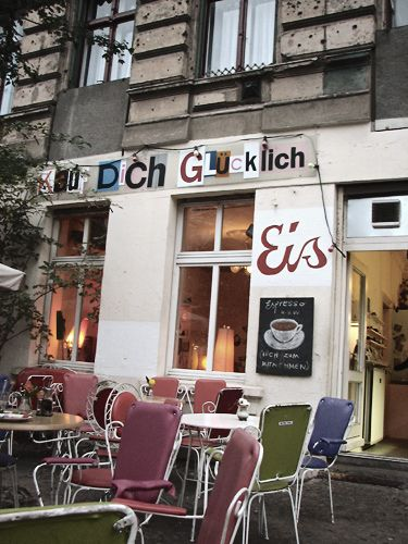 ice cream shop in Berlin, shop is called KAUF DICH GLUECKLICH which means: buy yourself happiness