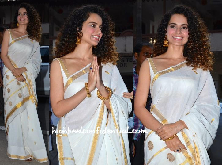 While at the Ramakrishna Mission, Kangana was photographed in a white and gold cotton sari. The classic look was finished out perfectly with gold jhumkis and bangles. Simple and timeless… Kangana looked absolutely lovely! Kangana Ranaut At Ramakrishna Mission Kangana Ranaut At Ramakrishna Mission Photo Credit: Viral Bhayani More guilt readingKeepin' It SimpleIn BurberryIn Anju …