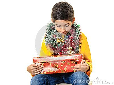 Download Curious Boy With Christmas Presents Royalty Free Stock Photography for free or as low as 0.69 lei. New users enjoy 60% OFF. 19,917,390 high-resolution stock photos and vector illustrations. Image: 35361417