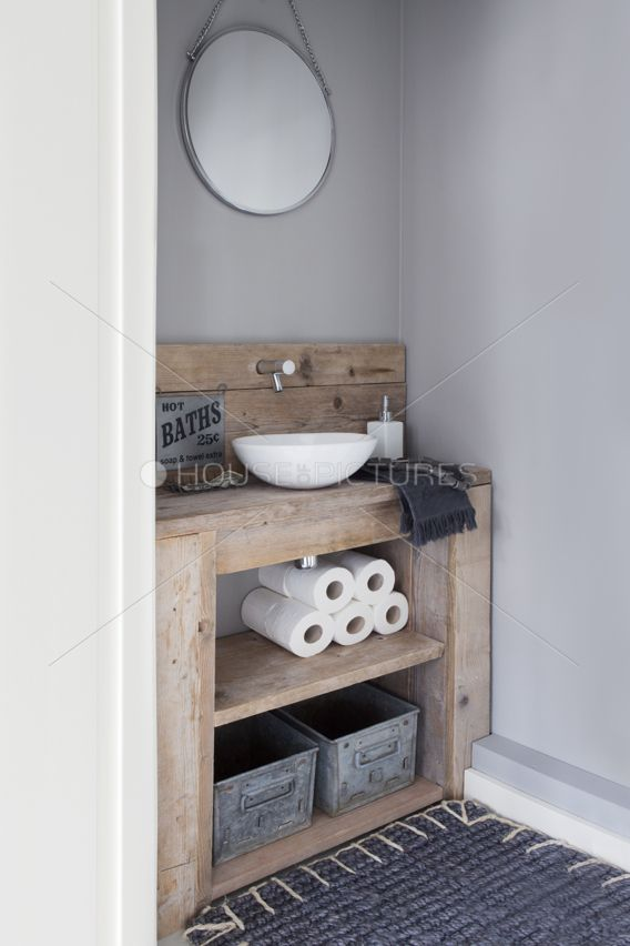 I'd love to have a rustic chic bathroom in our new home.  Good thing Eric's handy, he could make this cabinet.