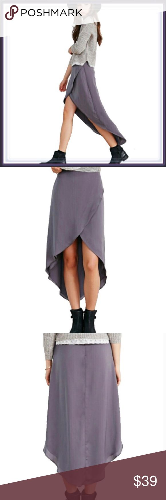 "Urban Outfitters Asymmetrical Tulip Midi Skirt ➖BRAND: Urban Outfitters  ➖SIZE: Medium- no stretch    ➖LENGTH: longest is 36"" at the back and the shortest at the front is 17"" and the skirt tapers from there to the back. ➖WAIST: 15"" ➖HIPS: 18-19""  ➖STYLE: A mauve purple tulip style asymmetrical high low Midi skirt ❌NO TRADE Urban Outfitters Skirts Asymmetrical"