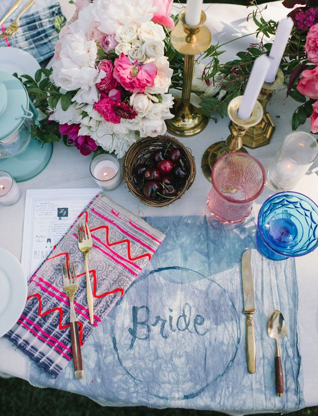 Bright colours - mismatched bold and bright napkins and indigo tie-died placemats.  Eclectic Garden Party Wedding: Erin + Greg
