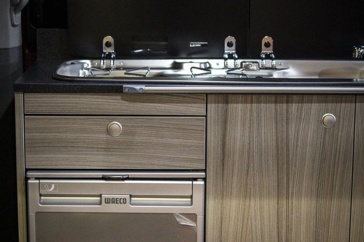 Driftwood furniture with Waeco CR-50 fridge and hob/sink combo