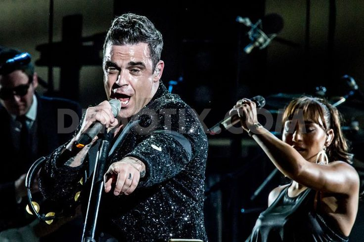 Pop star Robbie Williams performs live at San Siro Stadium in Milan by Sergione Infuso. July 31st 2013, Milan. http://www.demotix.com/news/2314938/pop-star-robbie-williams-performs-live-san-siro-stadium-milan
