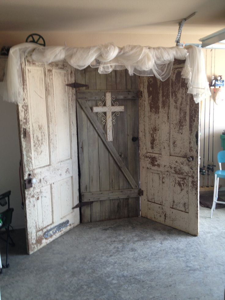 Old doors for wedding back drop.. love this! Just add some flowers and lace and it would be perfect!