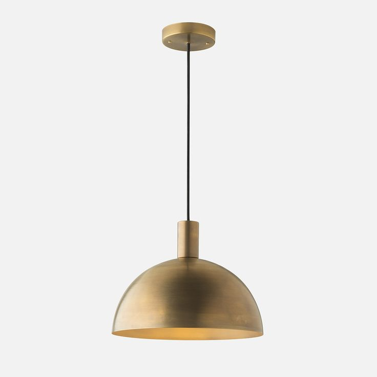 The Shelby Mod family draws its inspiration from a composite of beloved and influential design styles including the organic forms and evocative materials of the Scandinavian and Bauhaus movements.   Suspended from a simple Black Cloth cord, the spun brass shade's industrial silhouette is complemented by the rich warmth of our Natural Brass finish. Fitted with a porcelain duplex socket ideal for use with globe-shaped bulbs, the Shelby Mod is well-suited for workspaces and family rooms alike…