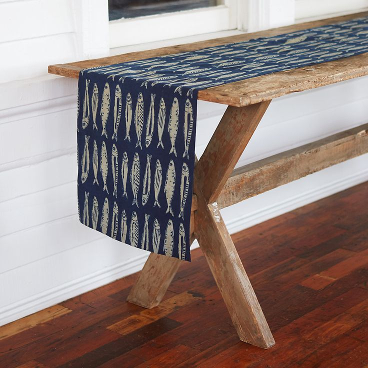 Hand-printed by skilled artisans, this cotton runner is dyed with rich, natural indigo. A school of sardines makes it a perfectly playful touch for the seaside kitchen.