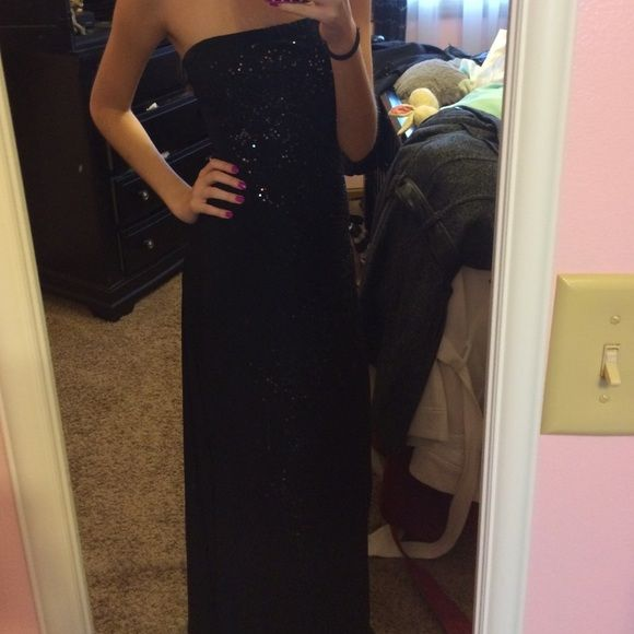 A long black dress with slit Black dress with sequins and slit worn once great condition! Kona  Dresses Strapless