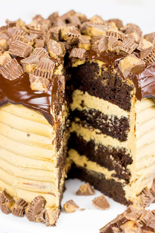 This Reese's Chocolate Peanut Butter Cake features a rich, moist chocolate cake covered in a decadent peanut butter frosting. Garnish with chopped peanut butter cups for a delicious dessert!