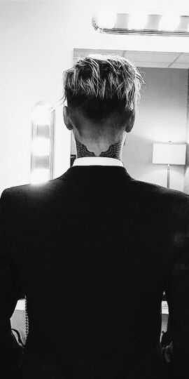 Justin's angel wings neck tattoo