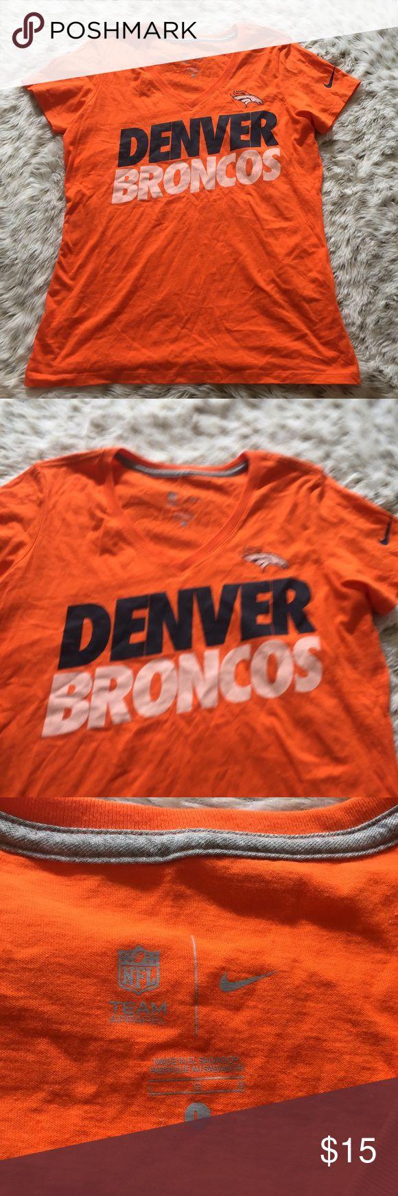 Nike Denver Broncos T shirt Nike women's size large orange and blue v neck t shirt! Denver broncos Nfl t shirt! Excellent used condition! Get ready for football season! Nike Tops Tees - Short Sleeve