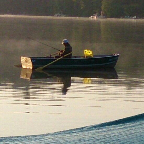 Pops first out in the morning silently in a rowboat www.sunnypointresort.com