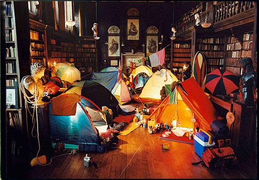 I would love to camp out at a library under thousands of great books.