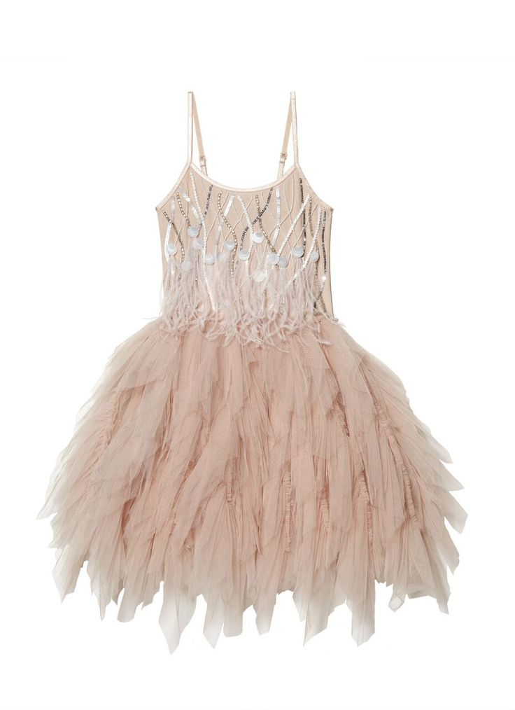 Our Desert Queen Tutu Dress features a dramatic full layered tulle skirt for prancing and dancing while a bodice embellished with delicate frothy plumes of ostrich feathers and sequin and beaded detai