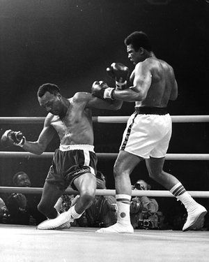 Ali knocks down Bob Foster in the eighth round of their 1982 bout.