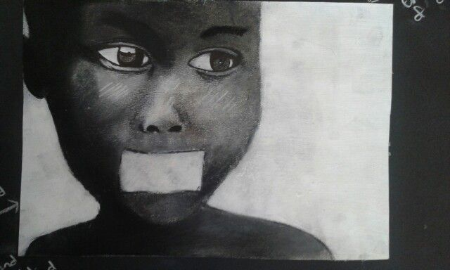 Charcoal and pen sketch-African boy- topic: emotional drama