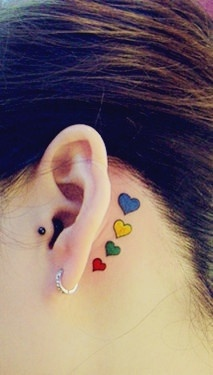 Main picture! Love behind there ear small bright tattoos