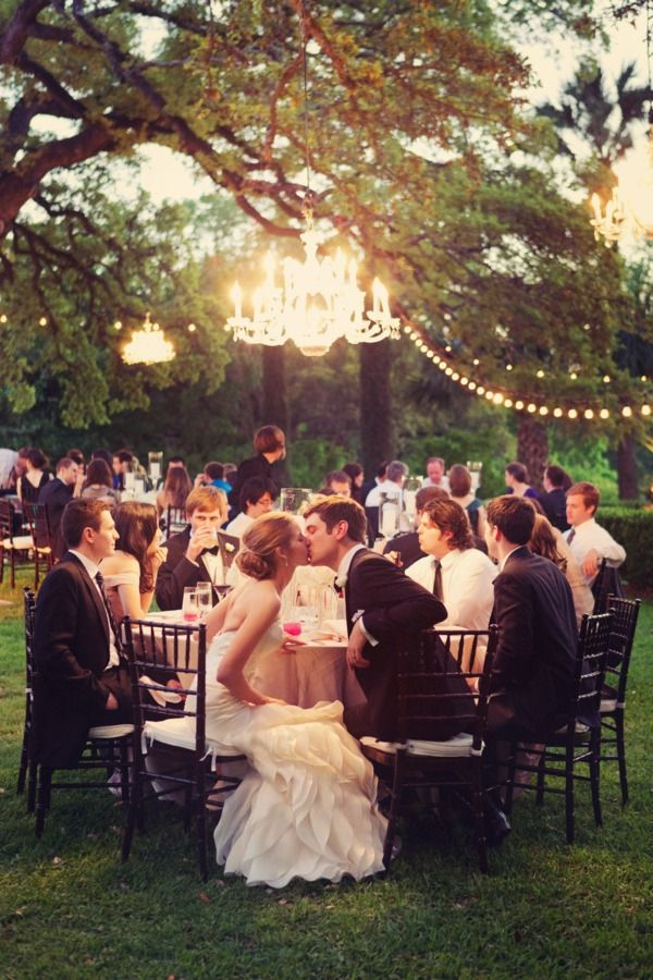 A chandelier in a tree with fairy lights? Sounds magical to me!