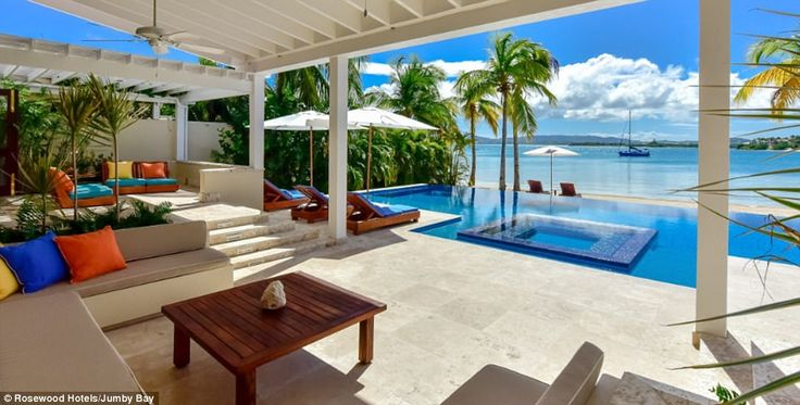 Room with a view:  Football ace Lionel Messi and his wife, Antonella Roccuzzo, are living it up on the Caribbean island of Antigua in the Rosewood Villa on Jumby Bay