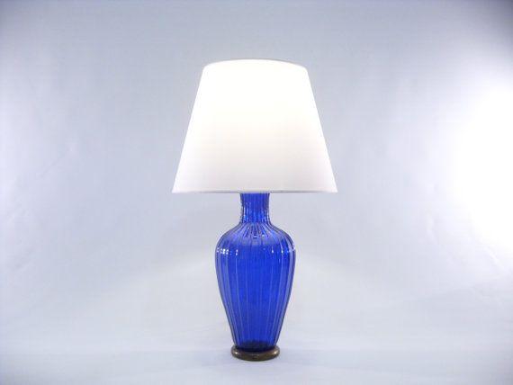 Delicious table lamp with Blue Murano glass base of the prestigious company Gabbiani in Venice. €1140,00