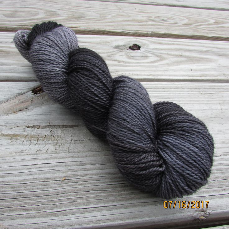 100% Superwash Merino fingering 2py. This colourway has many layers of greys, purples and blacks. Visit us on Etsy.com. We are Peppender Yarns