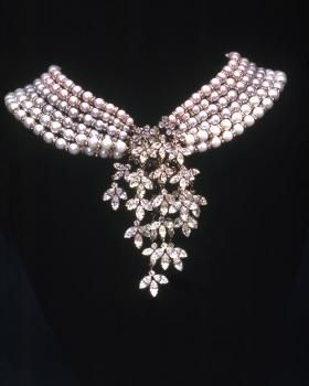 """Audrey Hepburn's famous pearl necklace that she wore in """"Breakfast at Tiffany's"""".  It is one of Audrey's most iconic pieces of jewelry.  It is unlike any other pearl necklace, with several rows of pearls going around the neck and beautiful little leave designs hanging from the centre."""