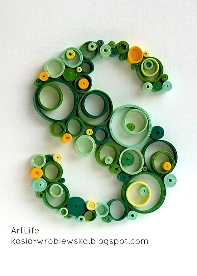 "hand crafted ""S"" ... quilling in running in circles ,. greens with spots of golden yellow .."