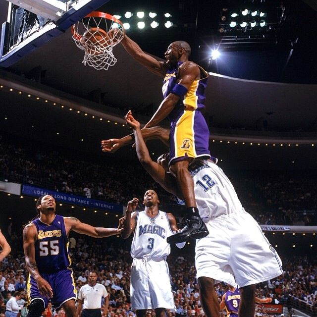 LA Lakers' Kobe Bryant dunks over Orlando Magic's Dwight Howard
