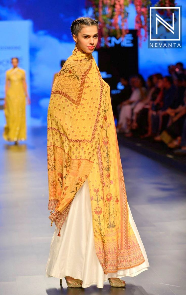 A white #lehenga sported with a #floral printed yellow #choli by #AnitaDongre
