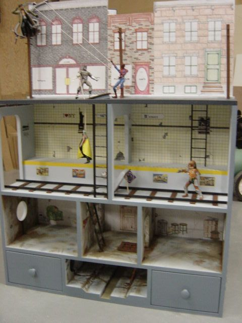 Action Figure City - I think this could be done better, but good idea for display or play for boys.