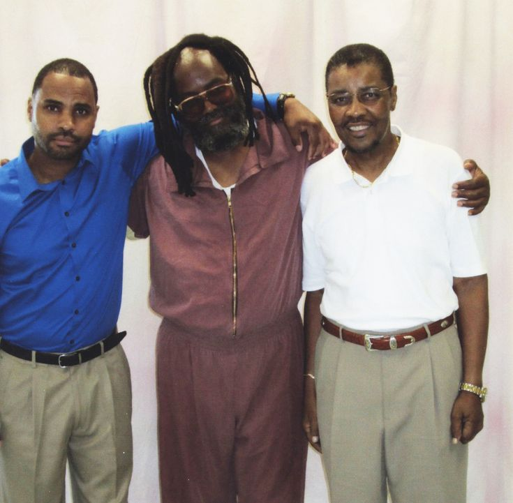 Mumia Abu Jamal (center) with beloved son Jamal (left) and brother Keith (right) in 2014.