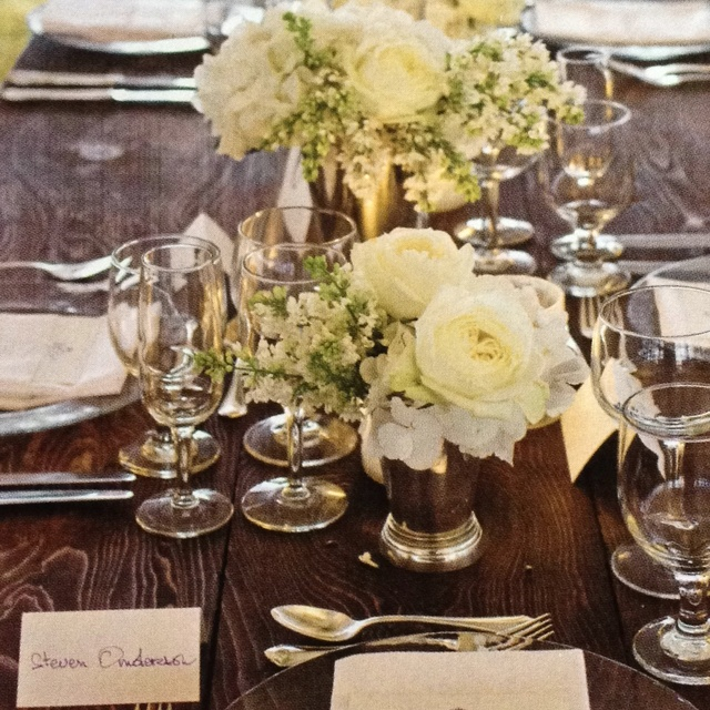 Gorgeous table setting with peonies, garden roses, lilacs and hydrangeas