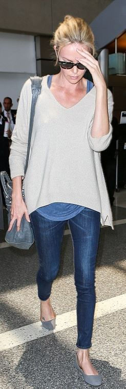 Charlize Theron: Sunglasses – Ray Ban  Earrings – Anita Ko  Jeans – Rag & Bone  Purse – Balenciaga