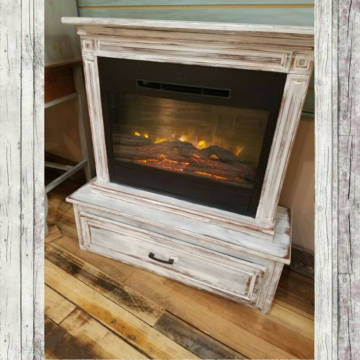Electric Amish fireplace. Distressed white with remote.  Heats great. Perfect for that warm and cozy feeling. $249.99 #cherisheverymoment #homedecor #fireplace