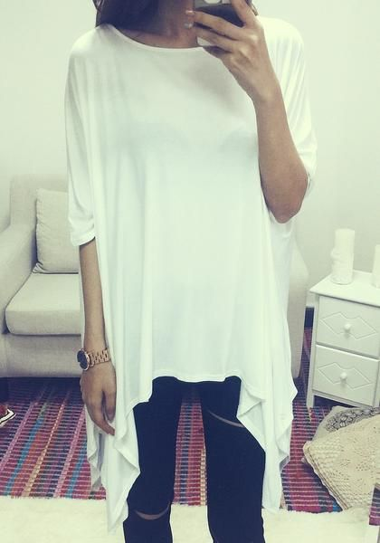 Tops // This white shirt comes with a loose-fitting and a boat neck to let you wear this one-shoulder style.