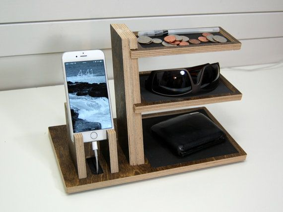 Charge your phone and organize your life in style with this wood docking station. Made to fit any smartphone on the market, with or without any case under 3/4 thick. - Integrated foam cord holder prevents the cord from slipping - Cork pads on bottom elevate base so cord can slip underneath - Fits phones and tablets for most cases- up to 3/4 (1.9 cm) thick - 12 (30 cm) wide, 6 (15 cm) deep, 7 (18 cm) tall - Baltic birch - EVA foam liners in 3 colors and 2 optional monogram styles for top…