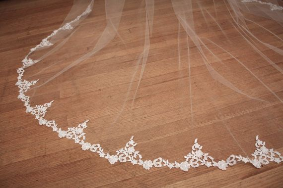 Couture embroidered floral motif lace veil. This lace is 3 at its widest, and tapers gradually along the sides. Lace starts at about 21 down from the comb (approx. elbow). Set on a silver metal comb, ready to wear. This veil is available in Chapel or Cathedral lengths. Please