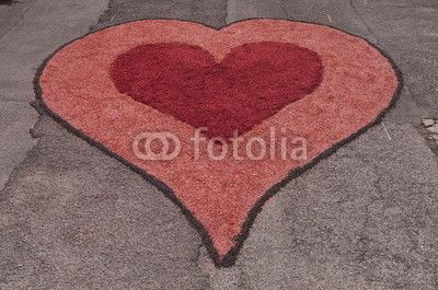 Heart inside another heart - Street art at Montefiore dell'Aso - flower petals composition on the street