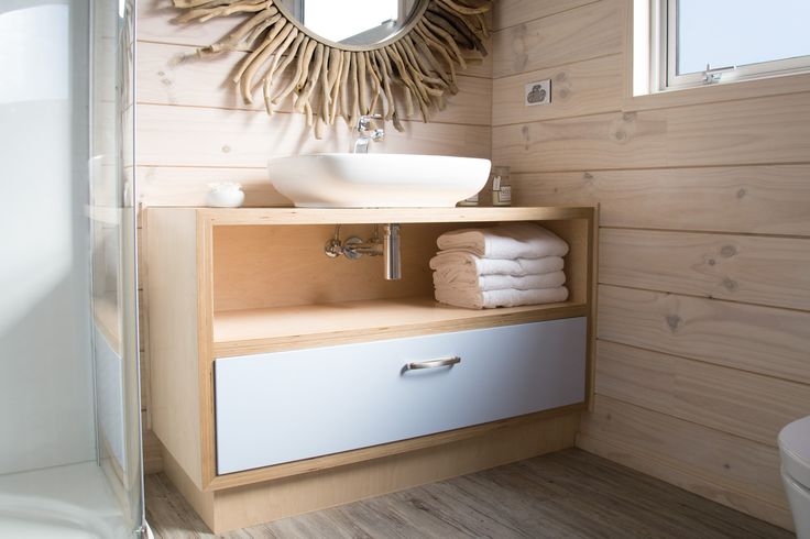 Washroom's furniture is also made from decorative Finnish birch plywood, which illustrates the wood grain beautifully.