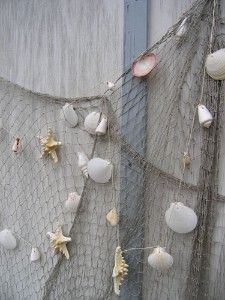 Beach decor for back yard fence.