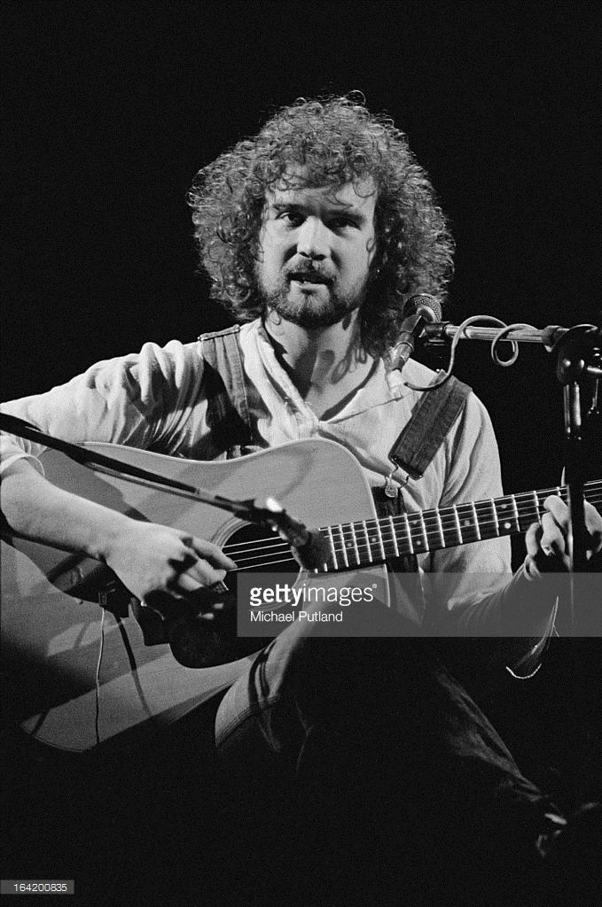 British singer-songwriter John Martyn (1948 - 2009) performing at the Rainbow Theatre, London, 1973. He is supporting rock group Traffic.