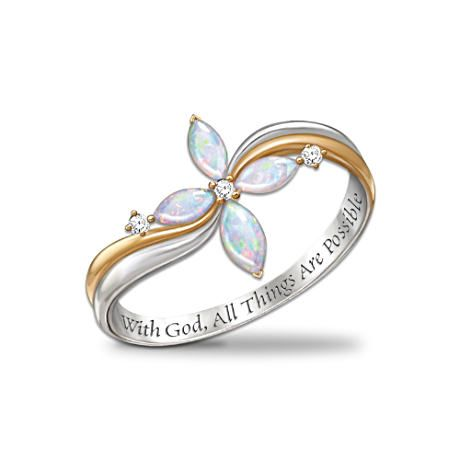 Faiths Purity ring.. The Opals represent the Cross that Christ sacrificed his life for our sins.. The diamonds represent the Father, the Son, and the Holy Ghost. The ring will be placed on her wedding finger.