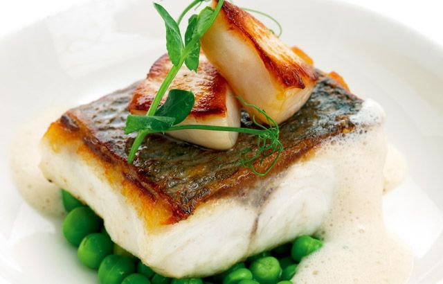 Pan-roast sea bass fillet with fresh garden peas and seared Jersey scallops
