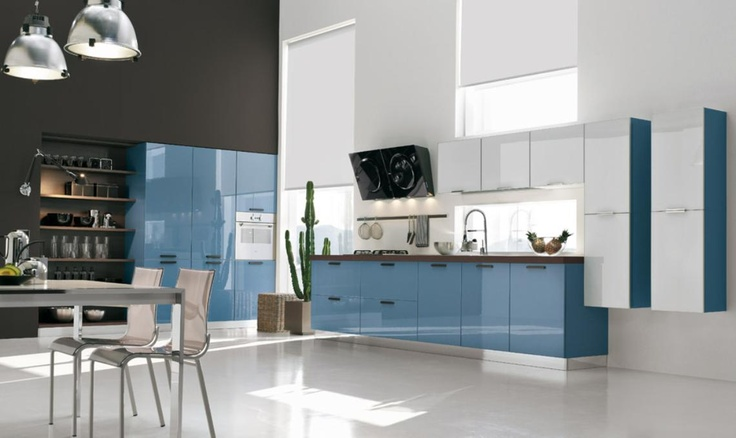 Cuisine design :: j'aime l'idée de mettre de la couleur sur le côté des armoires blanches