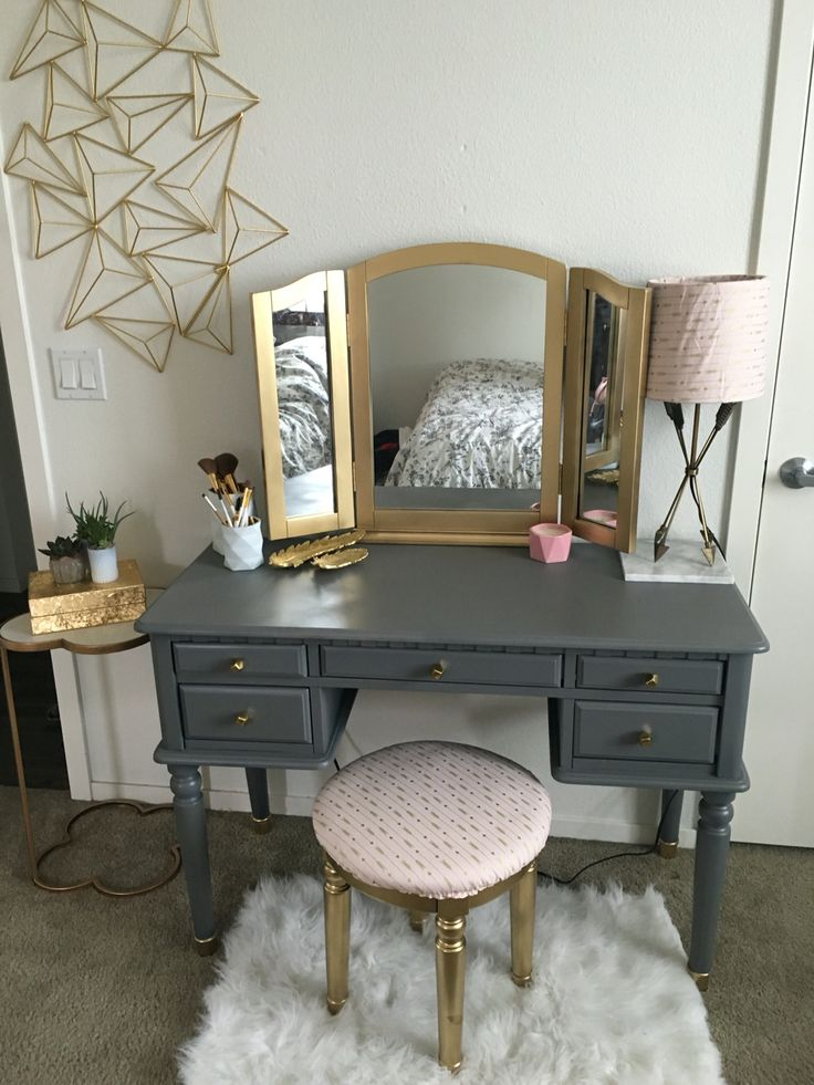 DIY vanity make over!  Spray painted my old black vanity matte grey and shiny gold. Upholstered my chair and lamp to match! Got some new coordinating nobs as well! All items purchased and Hobby Lobby, TJ Maxx, Plum Pretty Sugar - Brea,Ca and World Market!