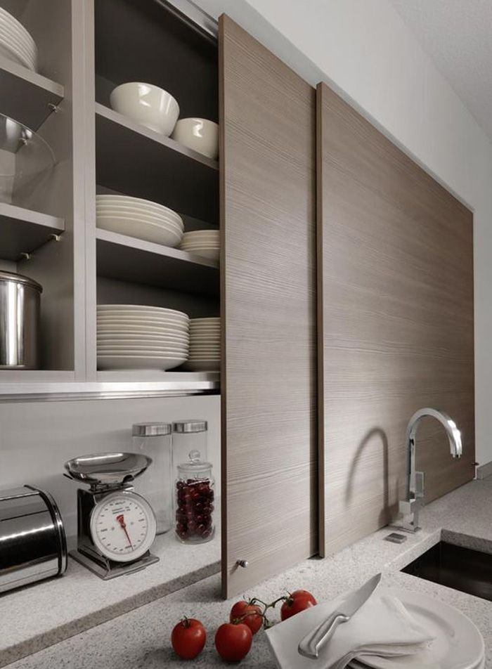 Beeck Kuchen Conceal Countertop  Thin sliding cabinet doors in a kitchen by Germany company Beeck Kuchen conceal countertop clutter.