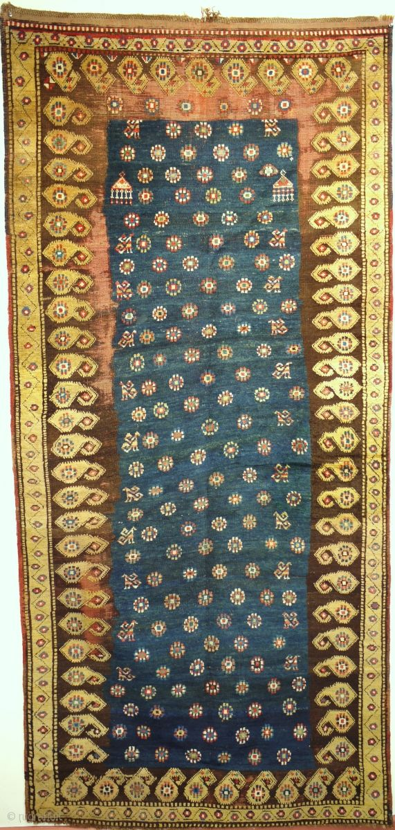very rare long rug from Azerbaijan second half 19C size 47 x 100 i. Subtle palette all natural dyes wool foundation corrosion to brown. Has one repair to bottom side ...