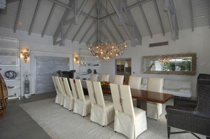 Decoration: Awesome Le Reve St Martin Beach House Dining Room Decor Featuring Natural Wooden Dining Table With Stylish White Leather Chairs Beneath Black Leather Armchairs On White Rugs In Addition To Attractive Chandeliers And Wall Lamp: Cozy Beach House For Vacation Places Idea