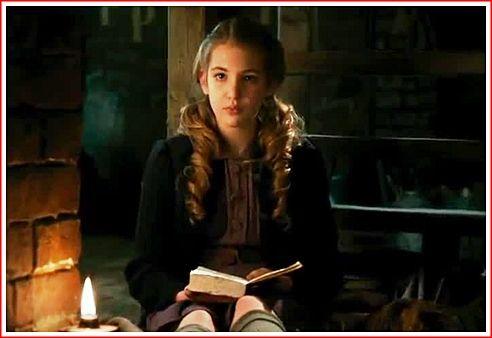 Liesel Meminger reading a book in her basement