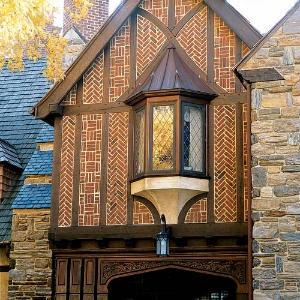 Known as nogging, bricks stacked between the framing timbers alternate between basket weave and herringbone patterns.